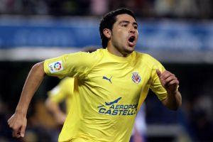 Foto Juan Roman Riquelme celebrando un gol con el Villarreal